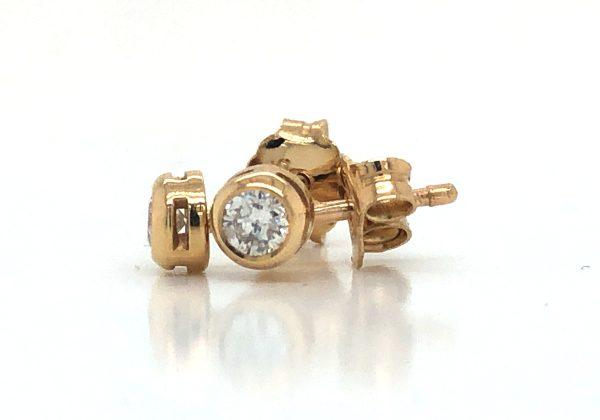 Gyémánt sárga arany button fülbevaló 0.164 ct